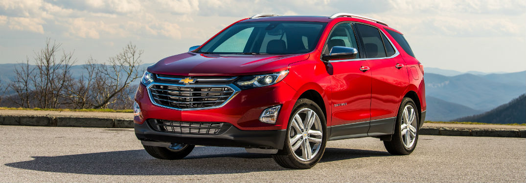 Front driver side exterior view of a red 2019 Chevy Equinox