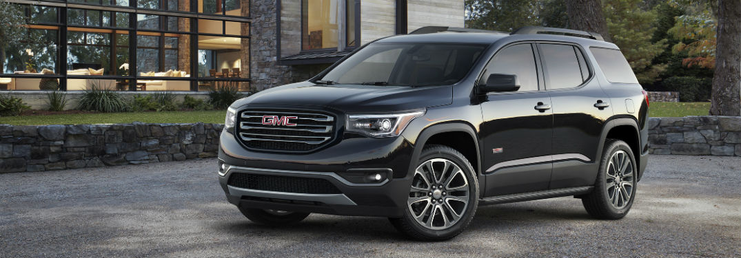 Front driver side exterior view of a black 2019 GMC Acadia