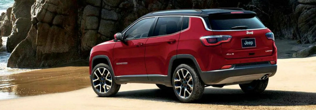 Rear driver side exterior view of a red 2019 Jeep Compass
