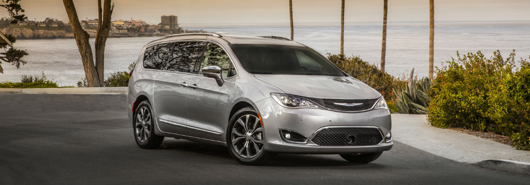 Front passenger side exterior view of a gray 2019 Chrysler Pacifica