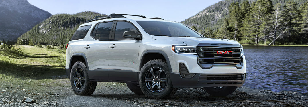 Passenger side exterior view of a white 2020 GMC Acadia