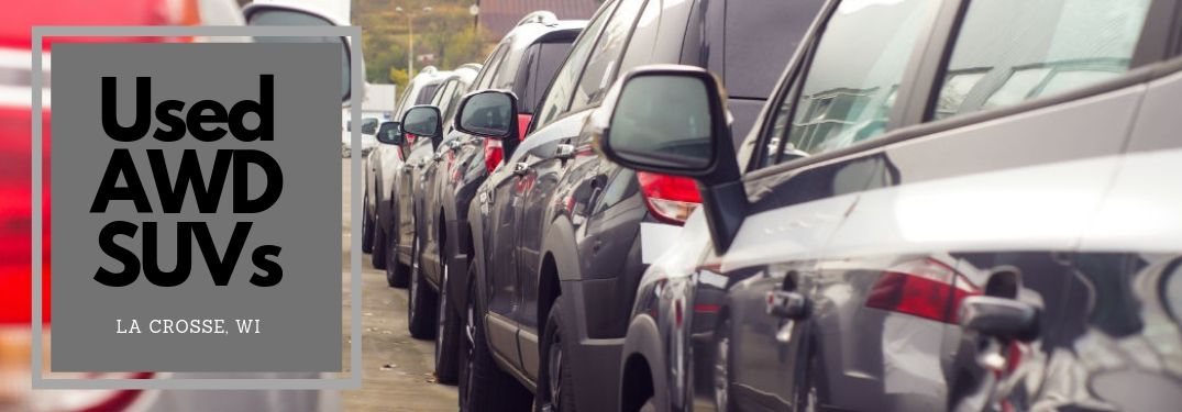 Used AWD SUVs in La Crosse, WI, text next to an image of used SUVs lined up in a row