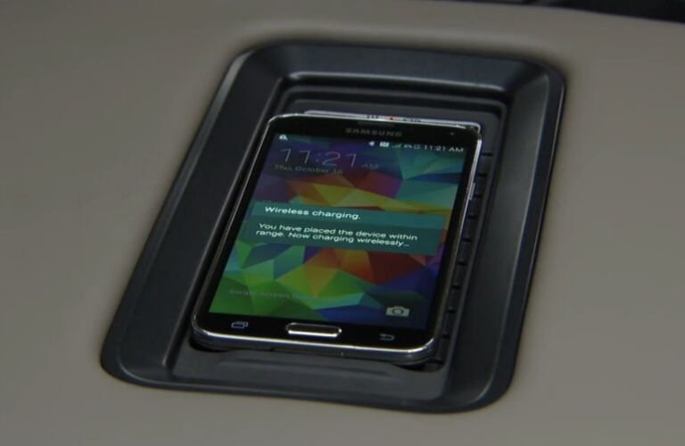 Samsung phone being charged on the GMC wireless charging station