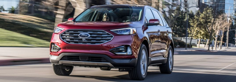 2019 Ford Edge driving down a street