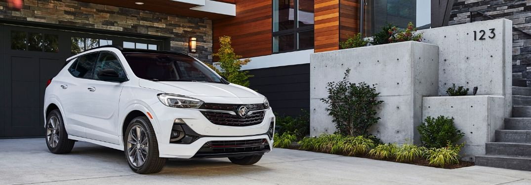 2020 Buick Encore GX in white parked outside a nice house