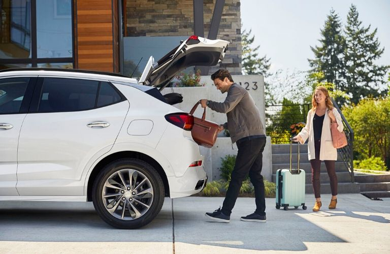 man and woman loading cargo into the rear cargo area of the 2020 Buick Encore GX