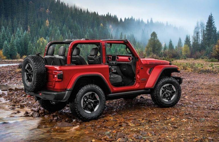 2020 Jeep Wrangler Rubicon parked near a mountain stream
