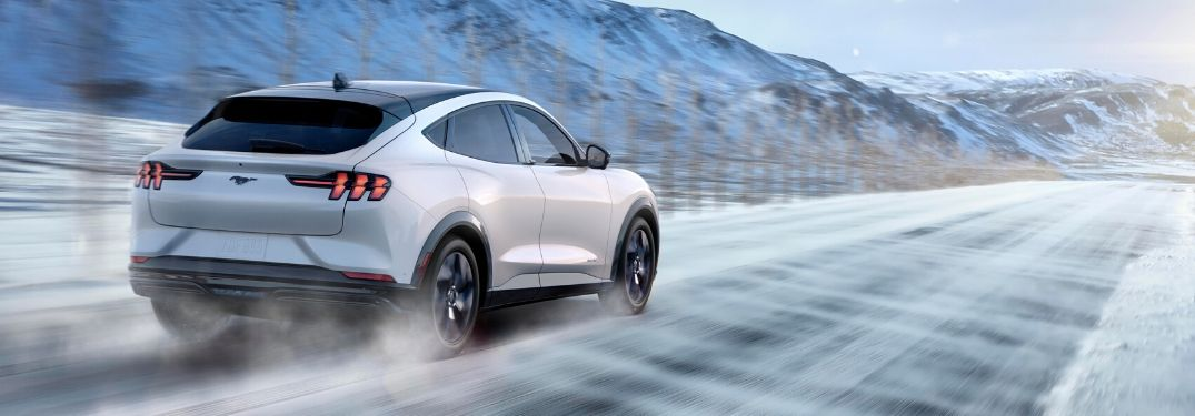 2021 Ford Mustang Mach-E driving on wintry road