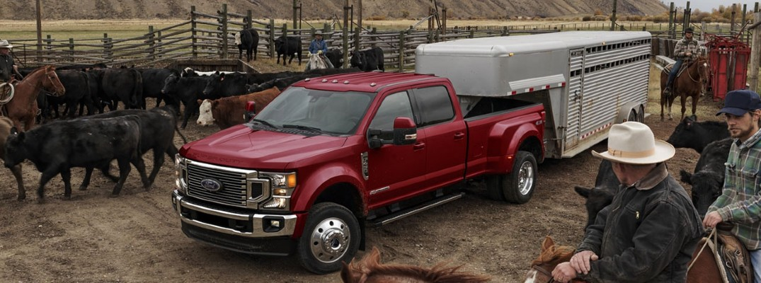 Red 2020 Ford Super Duty truck on a ranch