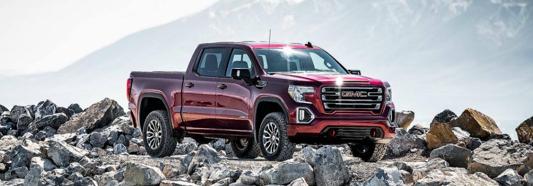 Red 2019 GMC Sierra 1500 AT4 parked on a rocky road