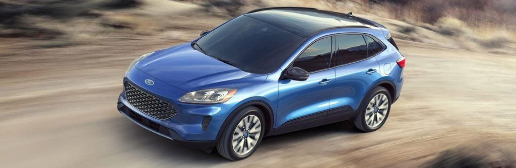Blue 2020 Ford Escape driving on a dirt road