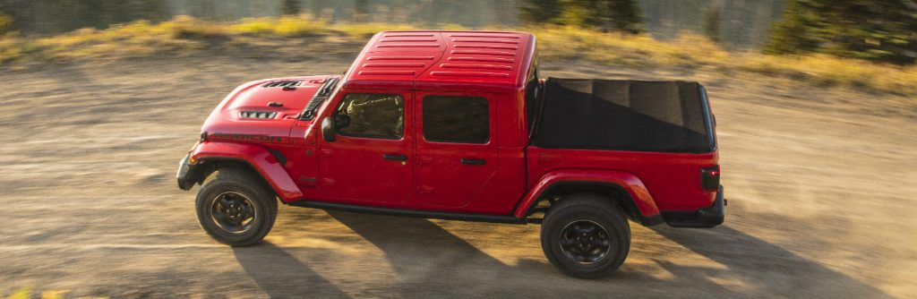 Overhead view of red 2020 Jeep Gladiator driving on a dirt road