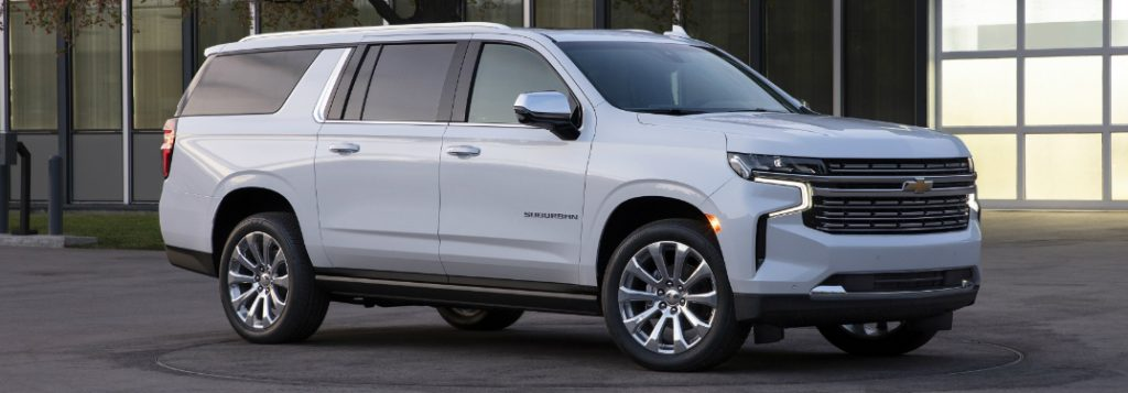 Passenger's side front angle view of white 2021 Chevrolet Suburban