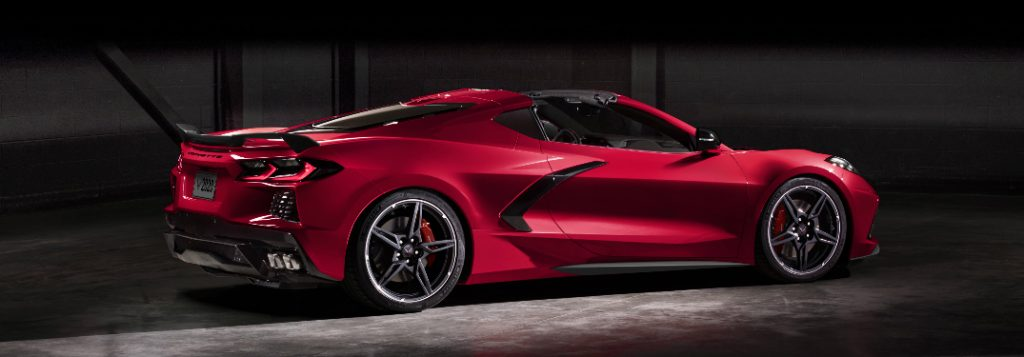 Passenger's side rear angle view of red 2020 Chevrolet Corvette Stingray