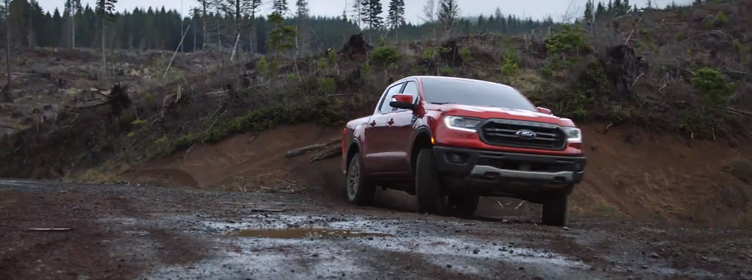 Red 2020 Ford Ranger driving on a muddy trail