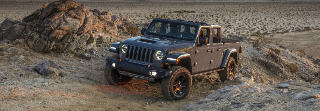 Grey 2020 Jeep Gladiator Mojave driving up a rocky hill