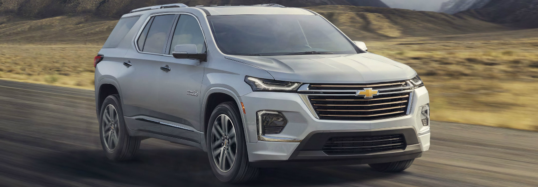 Passenger's side front angle view of silver 2021 Chevrolet Traverse