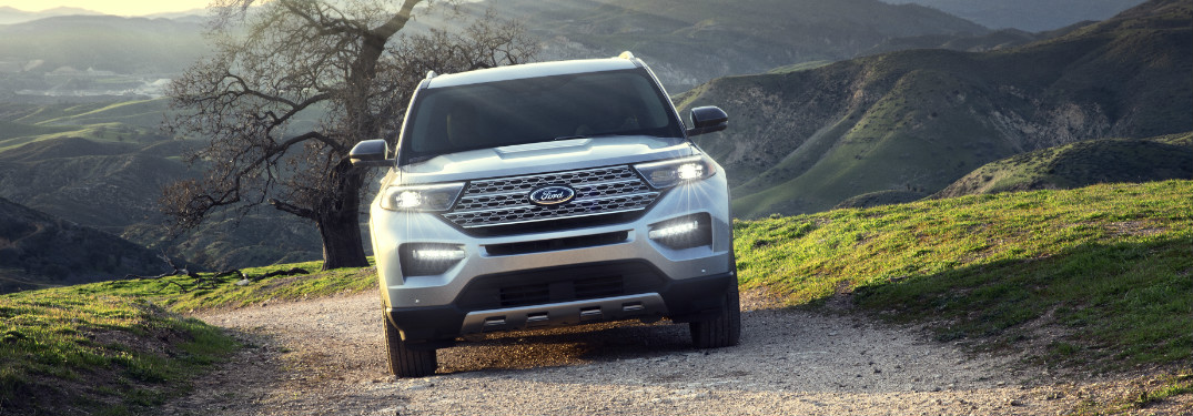 Silver 2020 Ford Explorer driving on a gravel road