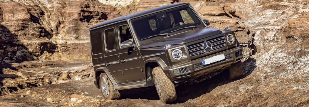 side and front view of the all-new 2019 Mercedes-Benz G-Class on the trail