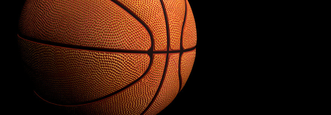 Closeup of a basketball on a black background