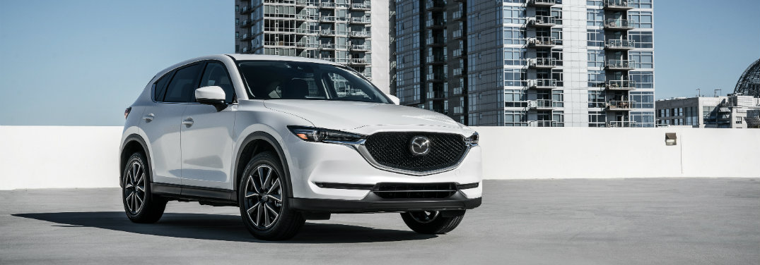white mazda cx-5 parked on top of parking ramp