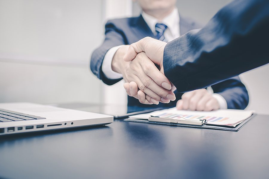 Two people shake hands on a deal