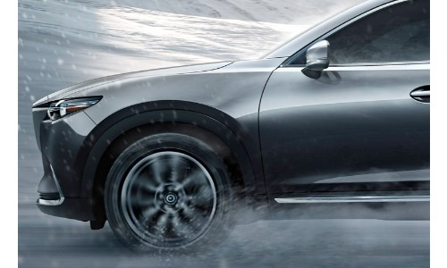 2019 Mazda CX-9 driving down wet road