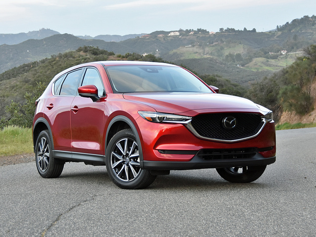 Red Mazda CX-5 by mountains