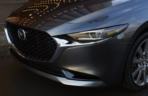 grille and headlight of silver mazda3