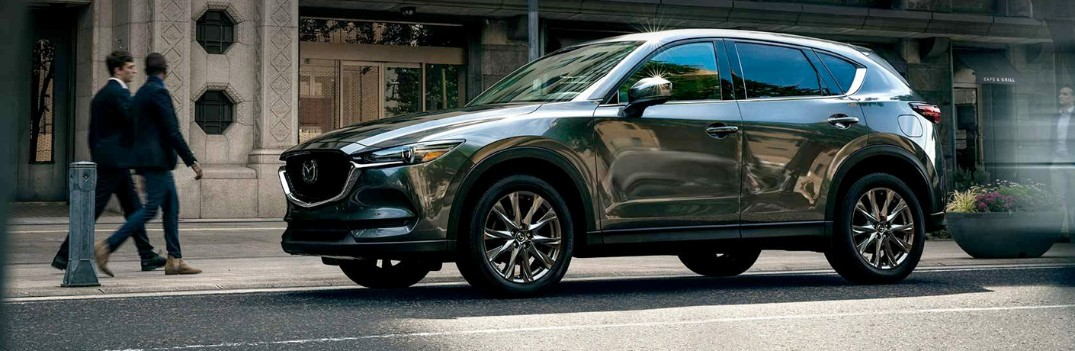 2019 Mazda CX-5 parked with people walking by it
