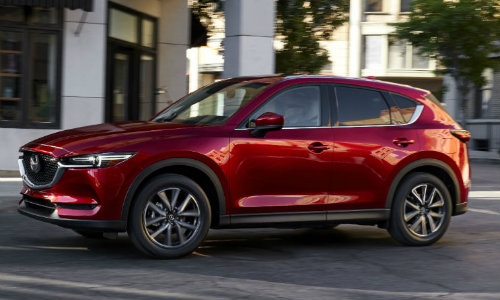 2017 Mazda CX-5 parked in the middle of an urban street