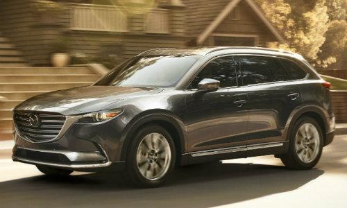 2018 Mazda CX-9 driving through suburban neighborhood