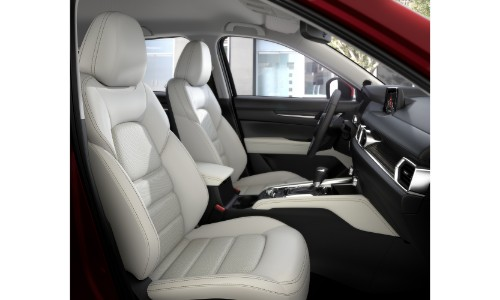 2018 Mazda CX-5 interior front seating side shot white cloth upholstery
