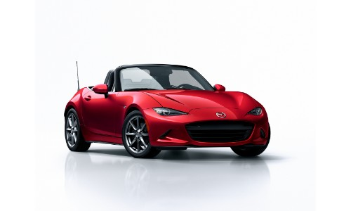 2018 Mazda MX-5 Miata soft top soud red exterior shot with a blank white background
