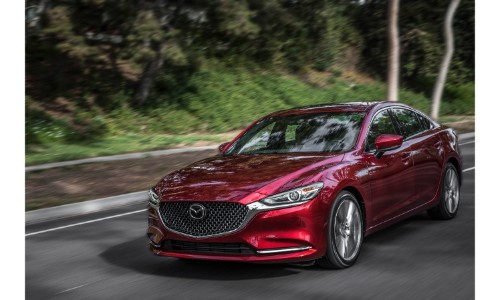 2018 Mazda6 sedan exterior red driving past trees and bushes