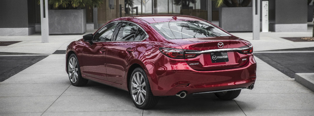 2018 Mazda6 full-size sedan exterior soul red back of trunk and bumper parked outside a luxury hotel