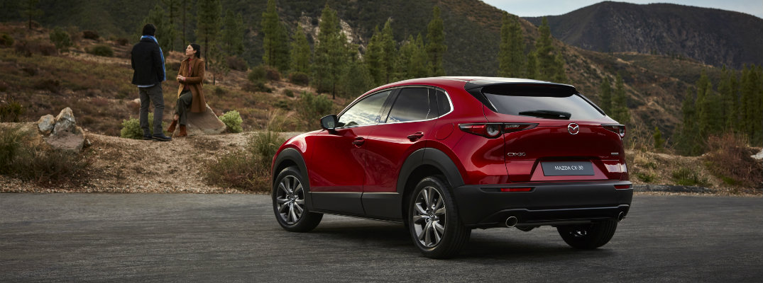 mazda cx  compact crossover suv exterior side rear shot  soul red crystal paint color