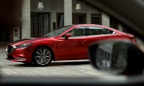 2018 Mazda6 parked in front of a car