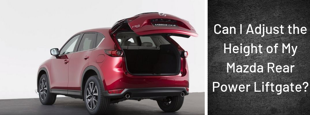 "Screenshot from Mazda Europe Youtube video of red Mazda CX-5 with liftgate open and ""Can I Adjust the Height of My Mazda Rear Power Liftgate?"" white text"