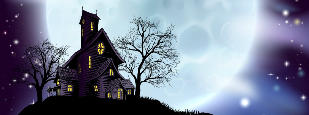 a dark and creepily lit manor haunted house at the top of a grassy hill near dead trees and in front of a giant, bright full moon for Halloween night
