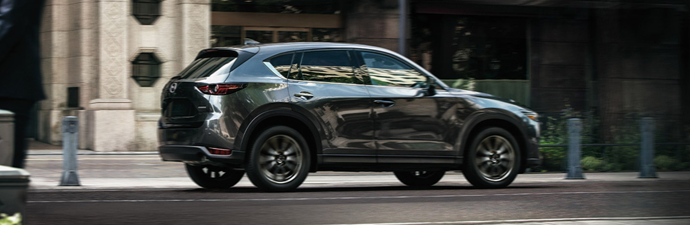 A gray 2020 Mazda CX-5 parked on a city road.