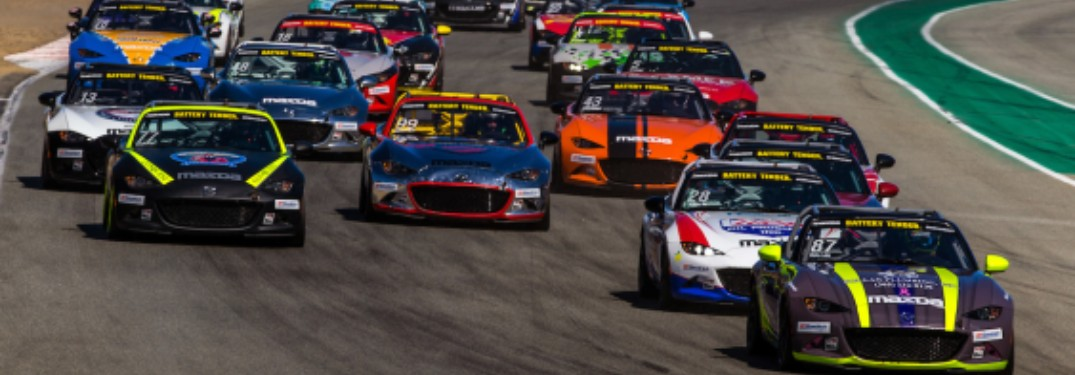 A gruoup of Mazda Motorsports vehicles during a Mazda MX-5 Cup in 2019.
