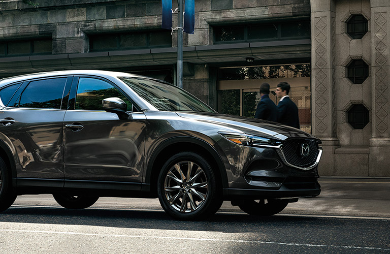 The front and side of a gray 2020 Mazda CX-5.