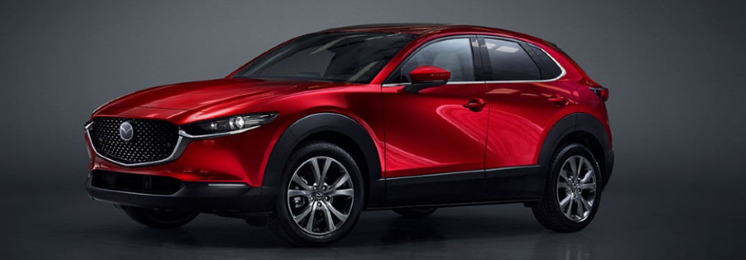 The front and side view of a red 2020 Mazda CX-30.