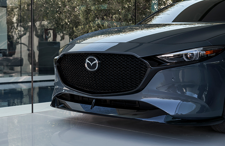 The front grille view of a gray 2021 Mazda3 Hatchback.