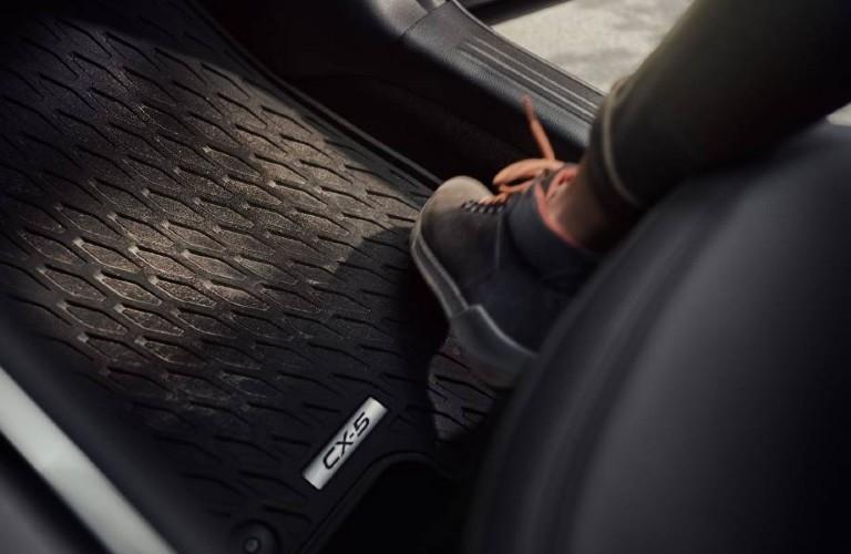 The floor mats inside a 2021 Mazda CX-5.