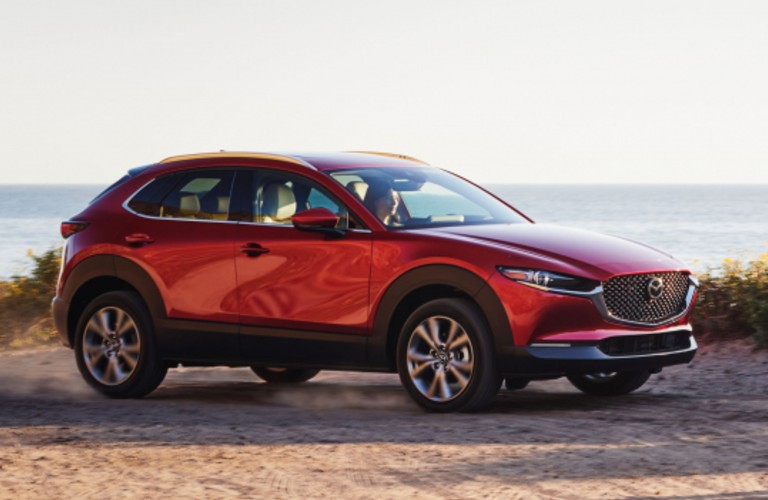 The side view of a red 2021 Mazda CX-30.