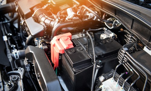 battery in engine compartment of car