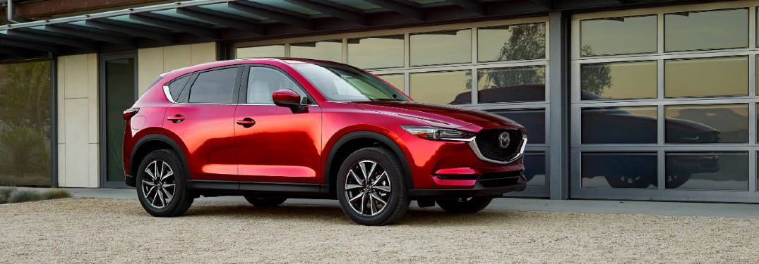 The side view of a red 2018 Mazda CX-5.