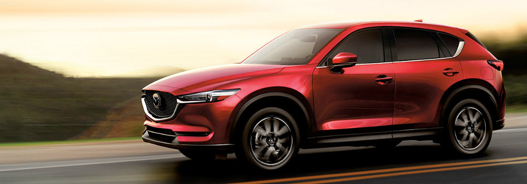 2018 Mazda CX-5 side exterior red on road